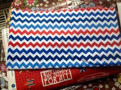"""""""Just received the fabric I ordered, plus a little something extra! Thanks so much, One Red Blossom Fabrics!! The yardage I ordered is for the back of my very first Quilt of Valor (which is also my first large quilt). The chevron print you sent is so pretty! I can't wait to use it in another QOV! """" -Laura R. G. Quilt Of Valor, Chevron, Zip Around Wallet, Fabrics, Quilts, Pretty, Red, Beautiful, Design"""