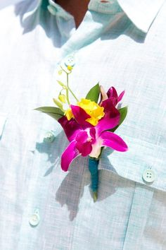 Destination wedding boutonniere idea - bright boutonniere of magenta orchid +  yellow flowers   {Crown Images photography by Sage}