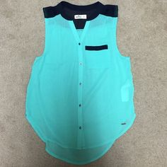 Hollister top Color is greenish. Never worn. Brand new but with no tag. Hollister Tops Tank Tops