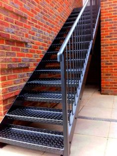 Want stairs and railing like this, but want hardwood steps on top of black metal. Industrial Interior Design, Industrial Stairs, Staircase Outdoor, Outside Stairs, Door Gate Design, Steel Stairs, Barn Renovation, Stair Handrail, Exterior Stairs