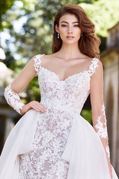 Martin Thornburg Martha, lace fit and flare wedding dress with sequin and metallic lace appliques, lace illusion cap sleeves and a v-neckline. Designer Wedding Dresses, Wedding Gowns, Fit And Flare Skirt, Tulle Gown, Fantasy Wedding, A Line Gown, Chantilly Lace, Lace Sleeves, Types Of Sleeves