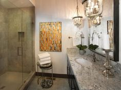 Don't be afraid to use big glass hanging light fixtures in your bathroom, it IS a room, after all. -  Bathroom Pictures From HGTV Dream Home 2014 on HGTV