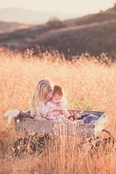 Sibling love love cute photography outdoors nature sun kids play sister cuddle siblings bunny