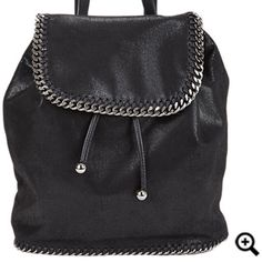 "Stella McCartney Backpack( seen on Kylie Jenner) Stella McCartney black faux-suede Falabella Shaggy Deer backpack.  Vegan-friendly faux leather Front flap and base detailed with whipstitching and chain-link accent; polished gunmetal-tone hardware Lined with Stella McCartney logo-jacquard fabric; zip pocket and logo tab at interior Adjustable shoulder straps Front flap closes with magnetic snap; drawstring closure beneath flap 13"" height x 11"" width x 4"" depth, approximately Made in Italy…"