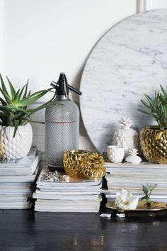 Candle in a ceramic holder: Candle in a pineapple-shaped ceramic holder with a…