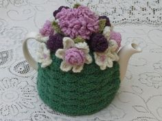 Cup Crochet Tea Cosy/Cosie/Cozy - Green with Dusty Pink and magenta flowers (Made to order) This listing is for a brand new crochet tea cosy teapot not included. The cosy has been handmade. Teapot Cover, Knitted Tea Cosies, Magenta Flowers, Crochet Decoration, Crochet Circles, Tea Cozy, Tea Art, Little Flowers, Crochet Home