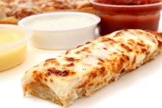 Garlic Bread Pizza Sticks  Ingredients: 1 batch 30-Minute Dough 2 cups mozzarella cheese, grated 2 cups (sharp) cheddar cheese, grated 1 head garlic 5 tablespoons unsalted butter, room temperature 1-2 tablespoons cornmeal 1/2 tablespoon olive oil kosher salt and freshly ground pepper, to taste marinara sauce, store-bought or homemade, for dipping ranch dressing, optional