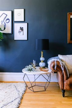 Modern Industrial Home Interior Design Inspiration featuring round coffee table used as end table next to brown leather couch with white throw, navy wall, boho rug Decor, Home Trends, Home Living Room, Home Decor, Room Inspiration, House Interior, Interior Design, Pinterest Home, Living Decor