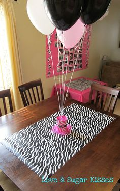Party Ideas... Empty Coffee Cans + Cute Paper + Ribbon = Centerpiece Balloon Holders.  Piece of Wrapping Paper = Cheap Table Runner