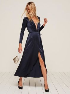 Smooth operator. This is an ankle length, wrap dress with a low v neckline and high slit.