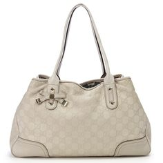 16cf4e41b6f Authentic Gucci ivory Guccissima leather Princy tote handbag. Features  gold-tone hardware