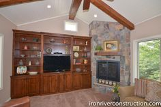 Stone fireplace, wooden beams, and porch remodel