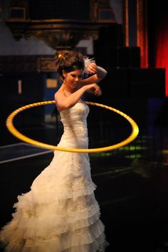 Tip #45901:  If being the bride isn't getting you enough attention from guests, show 'em your skills with a hula hoop!