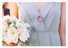 Light grey bridesmaid dress with white flowers.