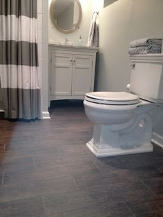"""Pinner said: """"Wood looking tile - Bathrooms Forum - GardenWeb  I got them local for just over $3 a sf, a great deal! They were on a board that had the brand name """"Mirage""""Name of tile was """"Woodstock"""" Color was """"Castagno"""". When I received the box the brand name was Energie Ker."""""""