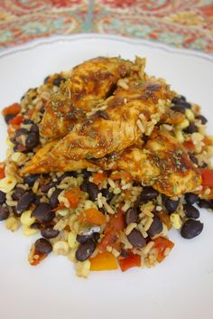 Santa Fe Chicken and Rice - one pot dish! Everything cooks in the same skillet. Seasoned chicken sautéed in the skillet, and simmered with rice, black beans, Rotel, corn and chicken broth. Full of flavor and ready in 15 minutes! Love easy and quick meals!