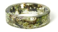 Beautiful, earthy bracelets are made with clear resin feature and pieces of nature.
