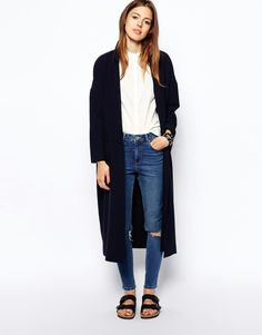 simple outfit. black duster, light colored shirt, skinny jeans, birks