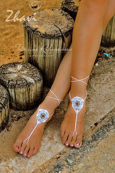 White Beach Wedding Beaded Crochet Barefoot Sandals crocheted from 100% cotton mercerized yarn with very beautiful beaded center. It is very beautiful and very convenient. Beads beauty and comfort crocheted barefoot sandals.  *** PRICE FOR TWO LEGS !!! **** Chose color of the yarn.  Very beautiful and original decoration for your feet.  Suitable for yoga, walks along the beach, for beach wedding, for photo shoots.  If you want to see all of my barefoot sandals please follow the link…