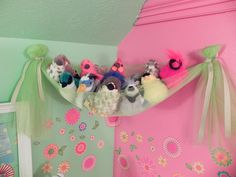 Hang a swath of tulle from Command hooks to create a stuffed animal perch. | 40 Smart Tricks To Keep Your Kids Organized