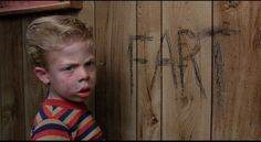 """Raising Arizona. """"That Buford's a sly one. (Draws 'FART' on the wall) He already knows his ABC's. Hit the deck, boy!"""""""