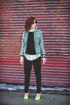 Blogger Glitterary styles her Gap camo jacket with a touch of neon.