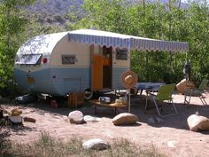 "While not a tent trailer, love the awning and ""front porch"" set-up"