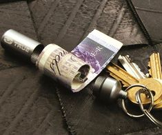 Keep some emergency cash on you at all times by carrying the keychain stash capsule. This useful keychain allows you to discretely hide a few bills in a waterproof aluminum capsule designed to keep it safe from the elements. True Utility, Stash Containers, Hidden Safe, Stuff And Thangs, In Case Of Emergency, Cool Inventions, Extra Money, Key Rings, Best Gifts