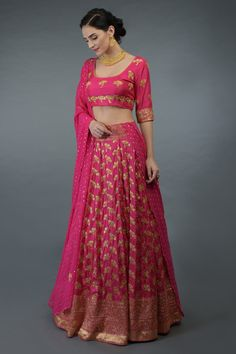 From our Bridal Heritage Collection, this hot pink banarasi meenakari zari handwoven pure silk lehenga outfit is embellished with gold beads and sequin hand embroidery all over. Banarasi Lehenga, Pure Georgette Sarees, Lehenga Skirt, Pink Lehenga, Soft Silk Sarees, Anarkali Dress, Indian Skirt, Dress Indian Style, Indian Dresses