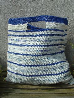 Don't know what to do with all those old plastic grocery bags?  Turn it into a new bag!  Check out this cool crochet recycled plastic bag...bag :P