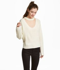 Natural white. Sweater in soft, rib-knit fabric with a small, ribbed stand-up collar. V-neck at front, dropped shoulders, and long sleeves.