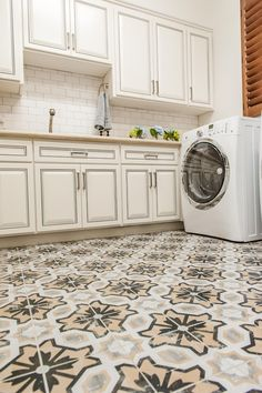 Thanks to the crisp white walls, soft white cabinets and white tile backsplash in this laundry room, the patterned tile floors steal the show. The floors add a stylish, global vibe to the otherwise simple, clean space. Laundry Room Countertop, Laundry Room Tile, Laundry Room Design, Types Of Hardwood Floors, Engineered Wood Floors, Vinyl Tile Backsplash, Kitchen Chair Pads, Cast Iron Kitchen Sinks, Eames Dining Chair