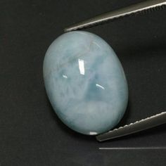 LARIMAR - The blue variety of pectolite has become known as Larimar. A very rare mineral, it has only been found in the Dominican Republic. Discovered only in 1974, Larimar is hard to find outside of the Caribbean. By chemical composition, Larimar is a hydrated sodium calcium silicate with manganese, and has a hardness of 4.5 to 5 on the Mohs scale.
