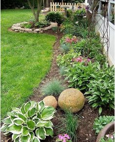 June - gardening. This picture shows the combination of planting, stone edging round a feature and sculptural art I am looking for, with bark chipping around. The sculptural art will be next months project :)