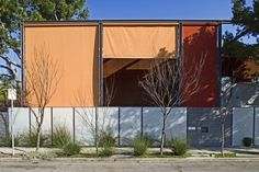 The shades are motorized and dramatically change and enliven the facade.; modern exterior by Ehrlich Architects