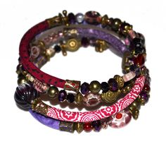 Purple, red and bronze adjustable wrap bracelet with glass and handmade fabric beads on memory wire by PurpleTurtleStore on Etsy https://www.etsy.com/au/listing/195647080/purple-red-and-bronze-adjustable-wrap