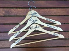 Custom Personalized Wedding Wood Hangers made with permanent outdoor-grade vinyl. Perfect for the bride to be, bridesmaids, maid of honor, flower girl, mother of the bride and mother of the groom. Hang your wedding dress and bridesmaids dresses for gorgeous wedding photos! They make great gifts for the bridal party. Choose your font style and text color.