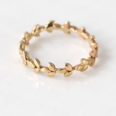 Vine Wedding Band in Gold // Gold Vine Wedding Ring // Intricate Organic Leaf Eternity Ring Design in Gold The organic leaves that make up this gold wedding band wrap all the way around the finger. This gold ring is lightly hammered to give Cute Jewelry, Gold Jewelry, Jewelry Rings, Jewelery, Gold Bracelets, Tiffany Jewelry, Pandora Jewelry, Jewelry Quotes, Gothic Jewelry