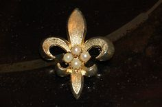 Fluer De Lis Brooch Vintage Heavily Gilted w/ 4 pearls very nice art deco piece.