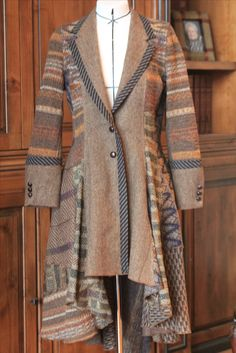 Pinned by Pat Congleton. Made from men's sport coat and various sweaters.