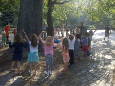Deva Madhava Das: These children are standing around 'the Hare Krishna Tree' in Tompkins Square park NYC. Famous as the place Swami Prabhupada began singing Hare Krishna, their teacher Deborah asked me 'is their a spirit in this tree?'