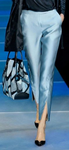 Love the front bottom slit on the pants. A nice design detail...
