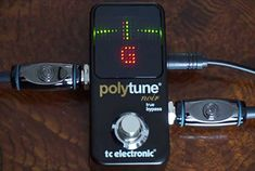 The TC Electronic Polytune Noir Mini 2 Pedal Tuner is an Ultra-Compact Tuner with Polyphonic, Chromatic and Strobe Modes plus a Display. Guitar Tuners, Pedalboard, Nintendo Wii Controller, Strobing, Led, Mini