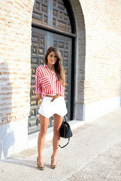 Not a fan of the shorts (or is that a skirt), but I do like the red/white stripe top and leopard print heels (with white pants or skirt would be my style...)