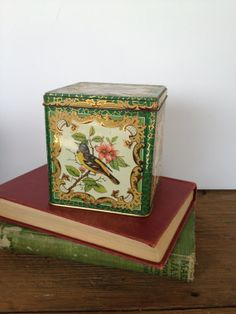 https://www.etsy.com/listing/189870158/vintage-tin-with-birds-and-flowers?ref=listing-shop-header-1