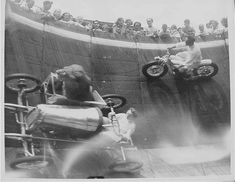 This has intrigued me for a while. A wall of death, in a car, with a lion in a sidecar. And then you look at the crowd and realise, there are people who are not particularly interested. What would it take? The lion on the motorbike?