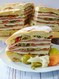 The muffuletta is an Italian sandwich that originated among the Italian immigrants of New Orleans, it's a mighty, hefty sandwich that has only has three very important components, bread, a spicy olive salad and Italian charcuterie. With Super Bowl coming Best Sandwich, Soup And Sandwich, Sandwich Recipes, Chicken Sandwich, Brunch, Italian Dishes, Italian Recipes, Italian Cooking, Muffuletta Sandwich