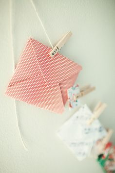 Advent calendar idea! Also the clothespins are a perfect way to hang and display Christmas cards!   From...  http://www.flickr.com/photos/sheenajibson/5236468494/in/photostream/