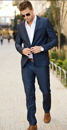 Navy Suit and white shirt. Clean, lean and always a winner!