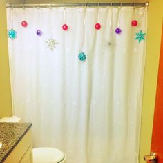 Couldn't find a cute Christmas shower curtain.. Sooo I hung ornaments on ribbon on a plain white one :)